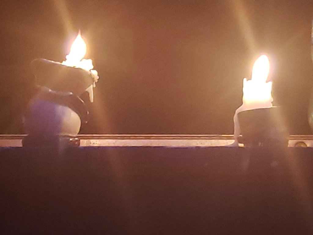 Two candles in the window during the end of July 2021